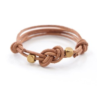 Infinity knot genuine leather in natural tan bracelet with brass cubics bracelet