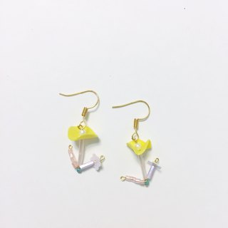 Curly yellow clip / pin earrings