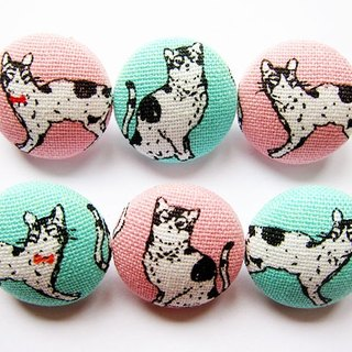 Sewing knitting fabric fastens hands as the material handsome cat Buttons