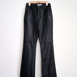 Pumpkin Vintage. Ancient black trumpet carved leather trousers