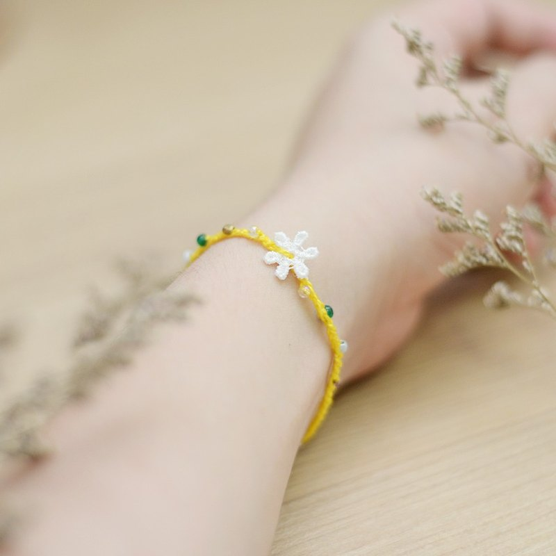 A handmade yellow knitting crochet bracelet by Niyome craft.
