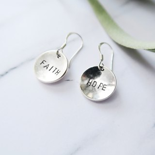 Bent round in sterling silver - a pair of custom lettering stamped earrings