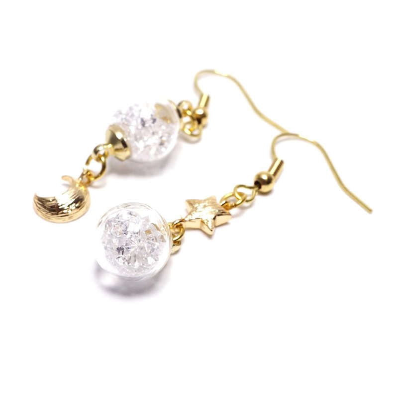 A Handmade moon and the stars white crystal ball earring asymmetry