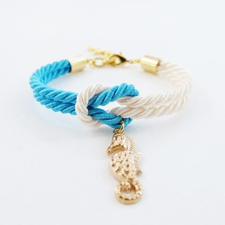Blue and cream knot bracelet with seahorse charm