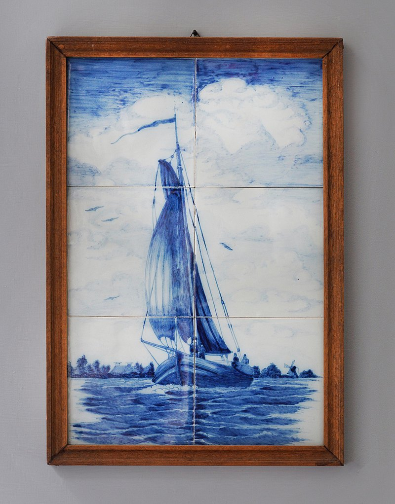 Wooden framed tableau of six blue tiles forming a traditional Dutch botter(T179)