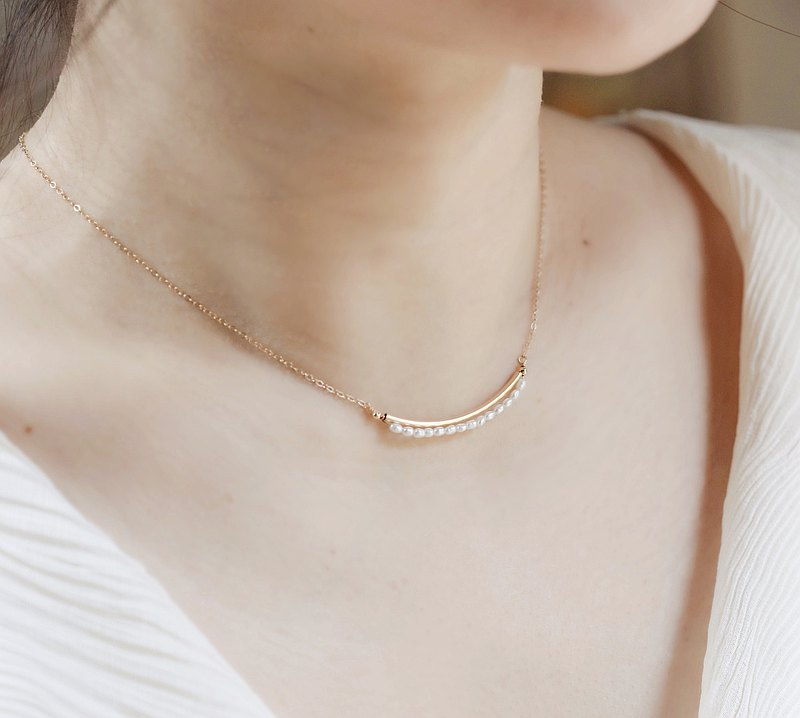 Smile blooming pearl elbow clavicle necklace. 14kgf