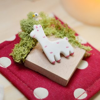 a little alpaca handmade brooch from Niyome clay.