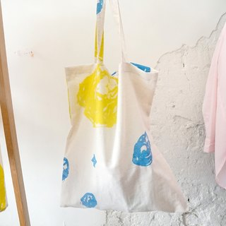 Hand-printed white rock hand-stamped cotton and linen carry Totten bags last