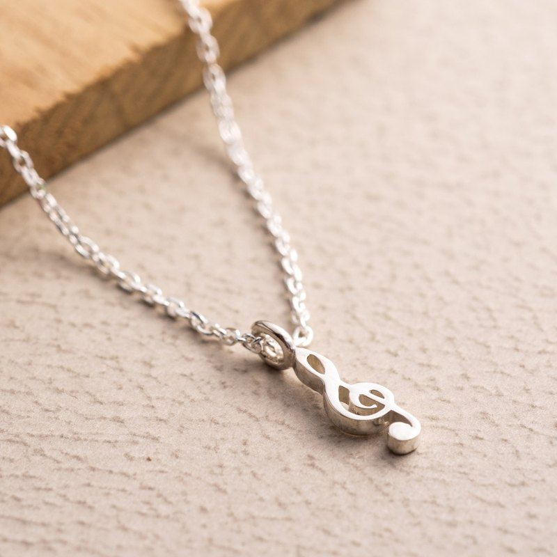 High bell mark small silver pendant