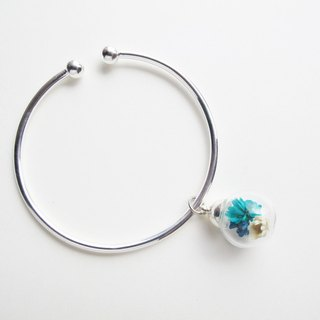 Rosy Garden Dried Blue Daisies inisde glass ball on a sterling silver bangle
