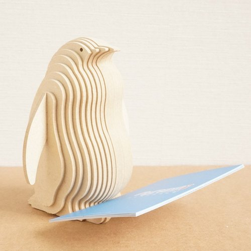 Wooden penguin business card seat