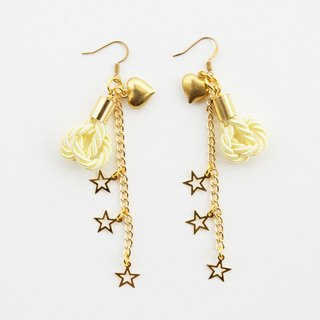 Yellow knotted rope and gold long-chain earrings with stars and heart