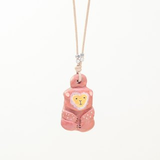a little lucky brown monkey handmade necklace from Niyome clay.