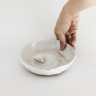 Bowl with floating object
