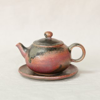 Wood fired pottery. Deep purple red natural ash flow glaze teapot