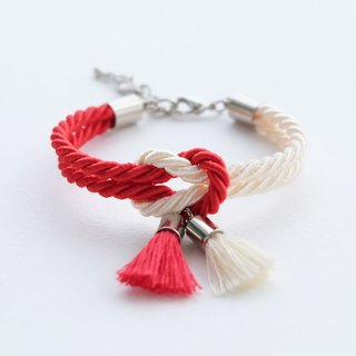 Red / cream knot bracelet with tassels