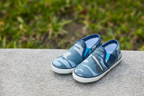 Confident. Camouflage blue children's shoes