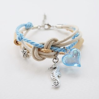 Ocean breeze bracelet with seahorse starfish wooden beads and heart charm