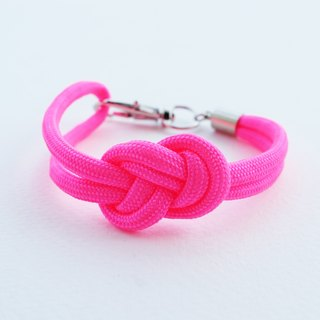Paracord infinity-knot with metal clip bracelet in NEON PINK