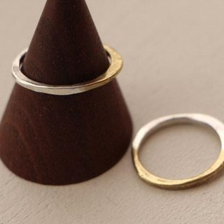 Brass and silver ring gently