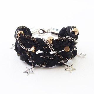 Black braided bracelet with silver star