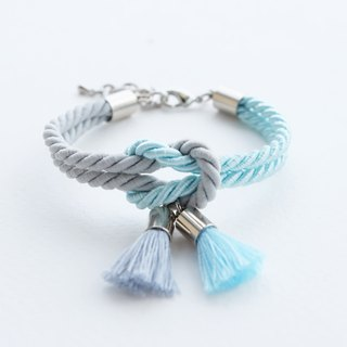 Matte ash / Icy blue knot bracelet with tassels