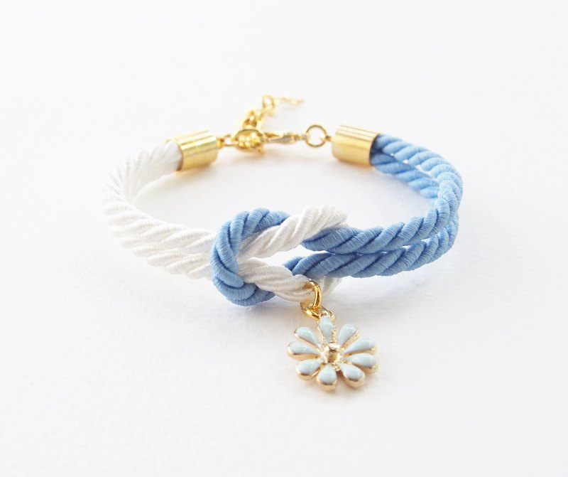 Matte blue and white knot rope bracelet with blue flower charm