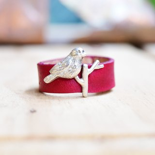 Branches of birds. Red silver ring