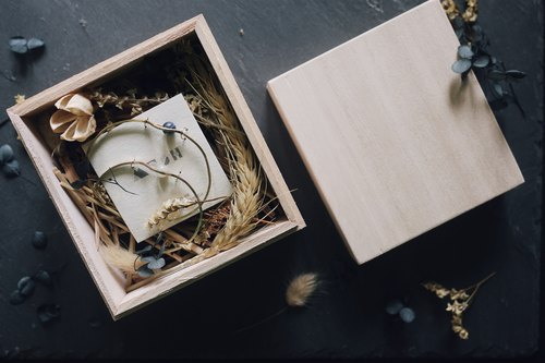 Wooden box with dried flowers
