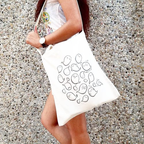 With three hand-painted canvas bag