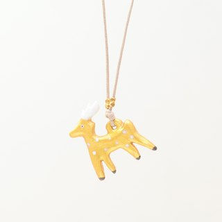 a little golden Christmas reindeer handmade necklace from Niyome clay.