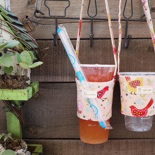 Pink bird hand bag drinks