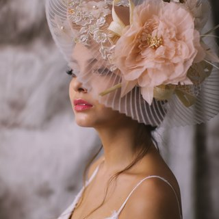 Millinery saucer hat in silk with handmade silk flowers