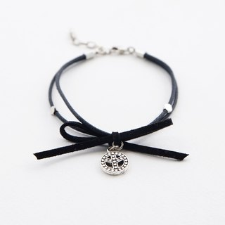 Black cord bracelet with suede bow and peace charm