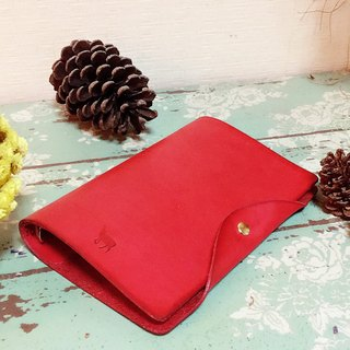 Red tanned leather handbook