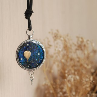 Painted deep blue hot-air balloon necklace