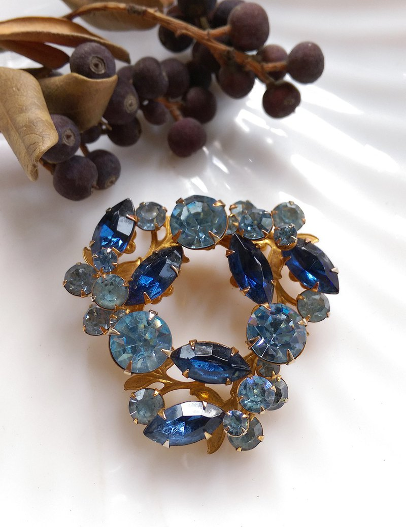 Western antique jewelry. Double blue diamonds shine brilliant big pin