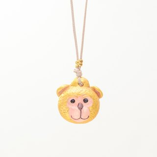a little lucky golden monkey handmade necklace from Niyome clay.