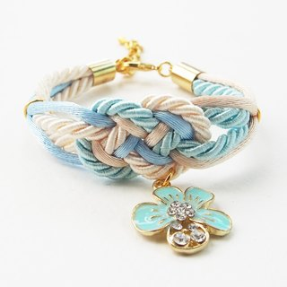 Light blue/Cream infinity knot rope bracelet with flower charm