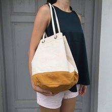 Off-white/ mustard Canvas 2way Bucket Bag w/  Strap Leather Handles.