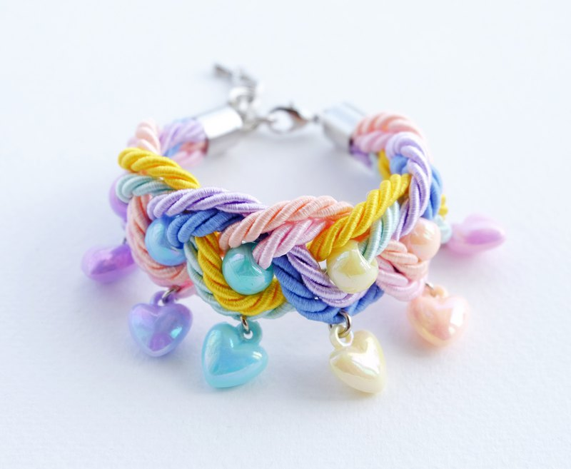 Colorful rainbow statement bracelet with pastel heart charm
