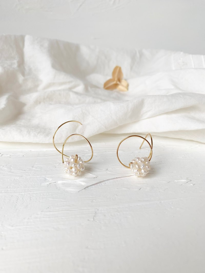 White Irregular Curved Rice Pearl Earrings