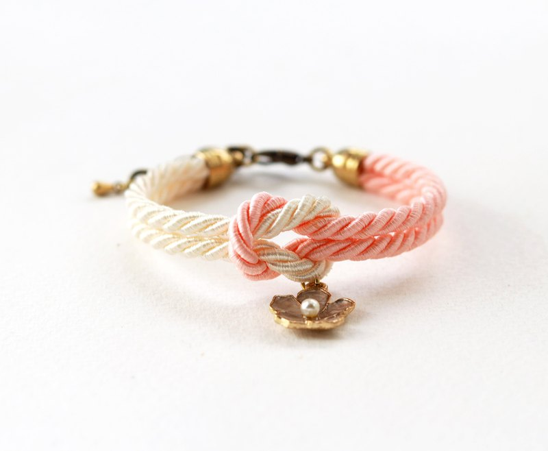 Peach /cream knot rope bracelet with flower charm