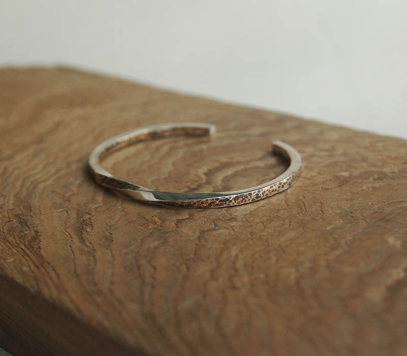 Reverse hand-wrapped silver bracelet