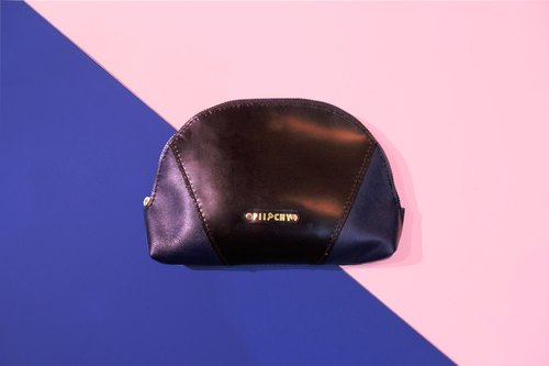 Skin in itching - hand stitching tanned leather cosmetic bag <shell shape>