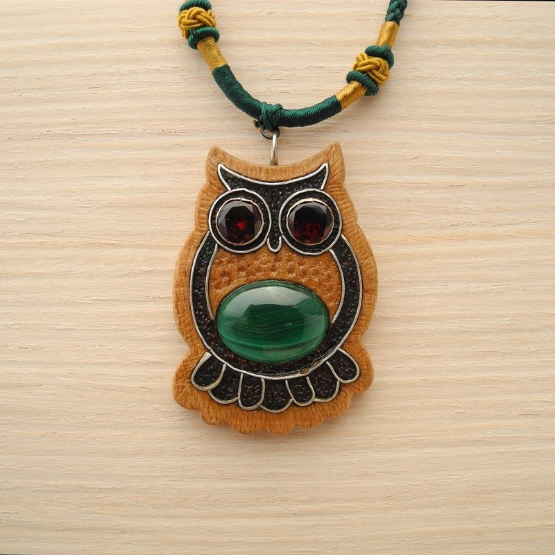 Wooden inlaid owl pendant with malachite and garnet