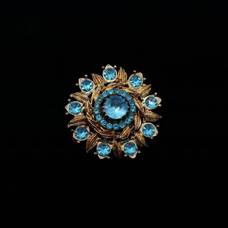 Pumpkin Vintage. Retro radiation pattern blue diamond brooch