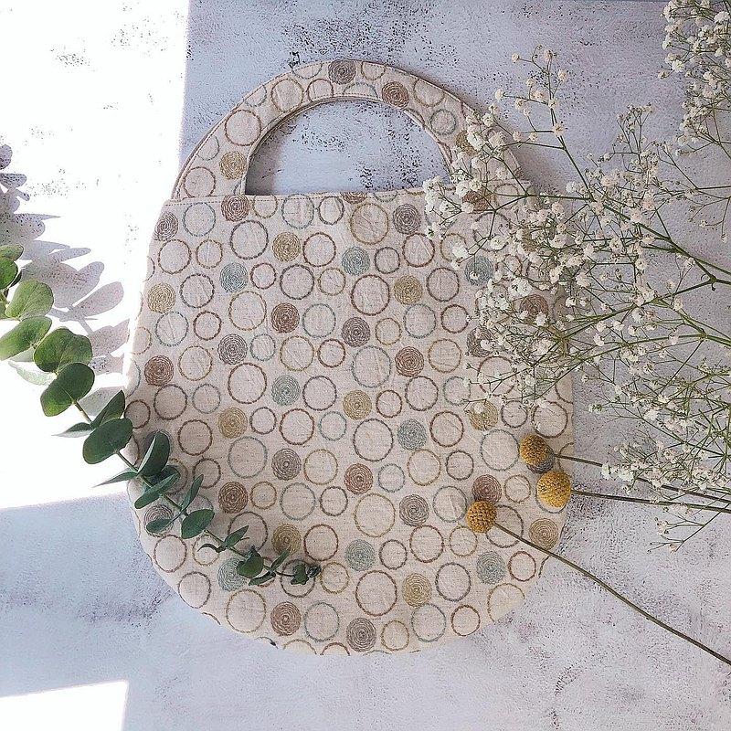 平面橢圓蛋型手提包-杏色刺繡圈圈