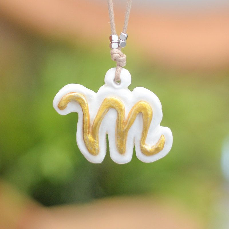 The M alphabet letter handmade necklace from Niyome Clay.