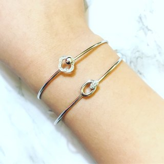 Oval spring gold wristband
